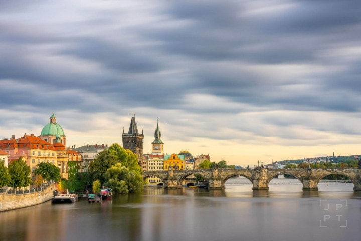 Charles bridge with moving clouds, Prague
