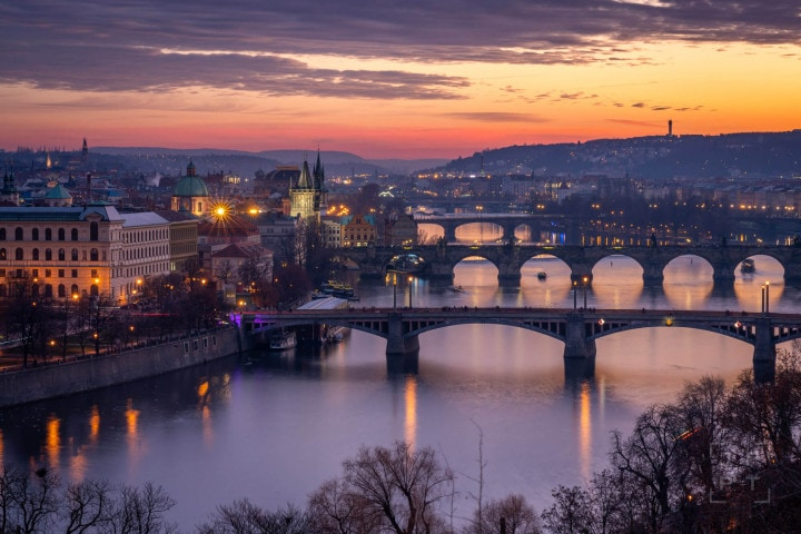 Prague skyline and bridges at sunset