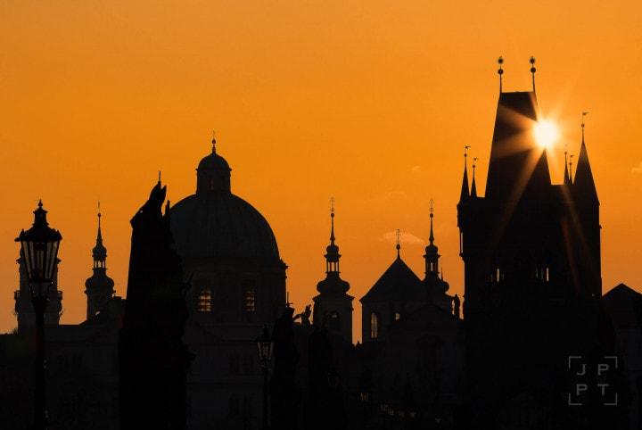 Sun rising Charles bridge tower
