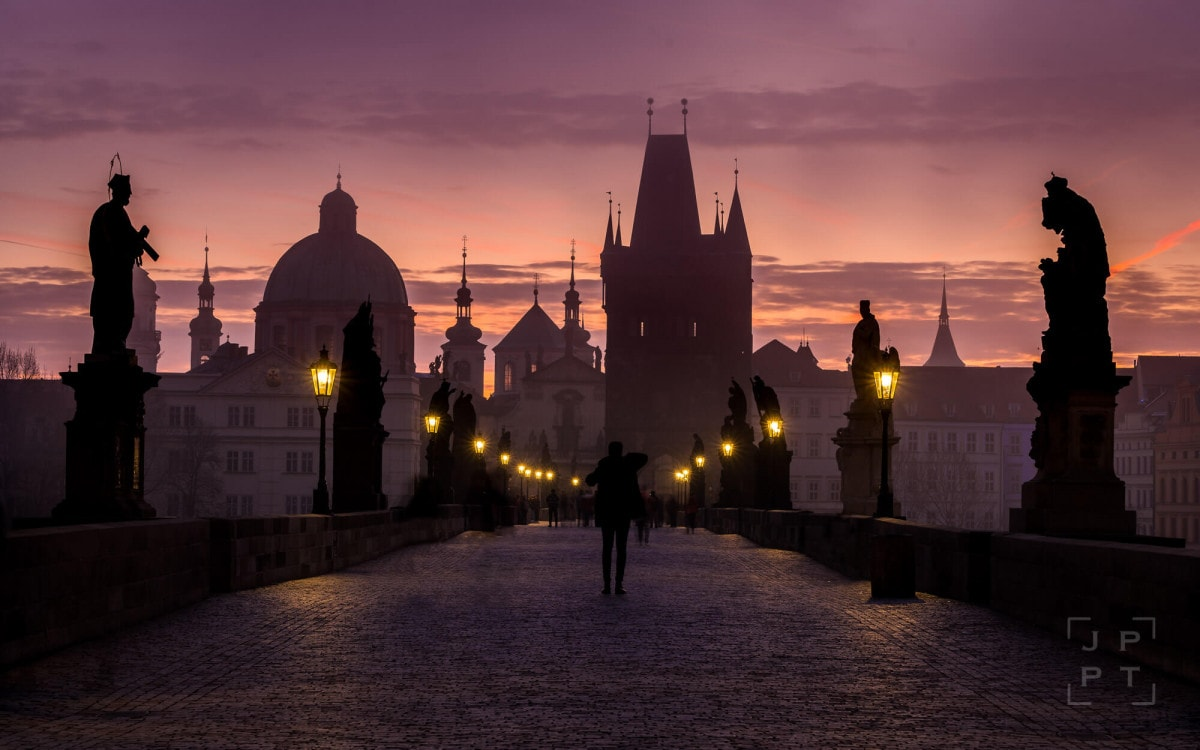 Charles bridge at sunrise with colorful sky, Prague